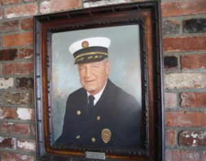 A portrait of Fire Chief Fred Miller that hangs at the EG Volunteer Fireman's Hall.
