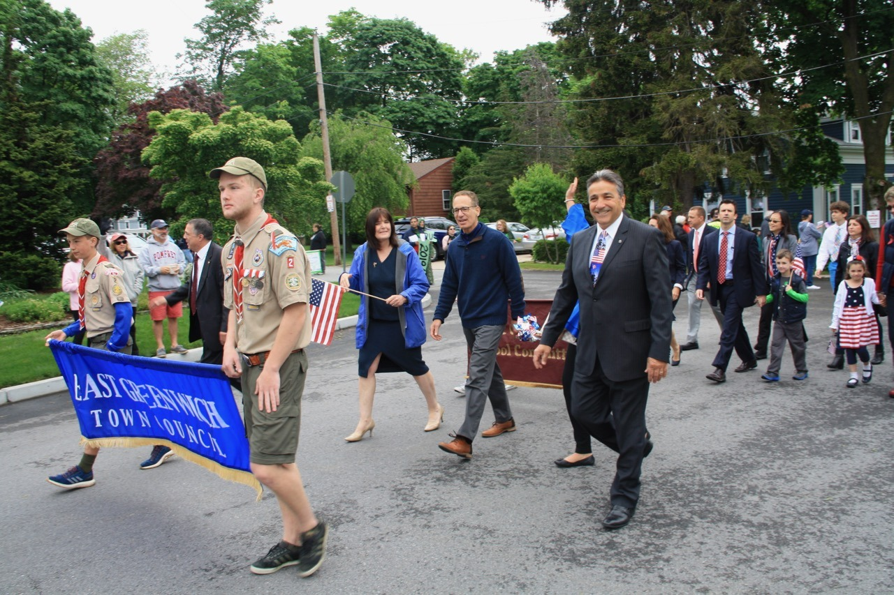 State Rep Anthony Giarrusso, right, marches beside Councilman Mark Schwager and Council President Sue Cienki.